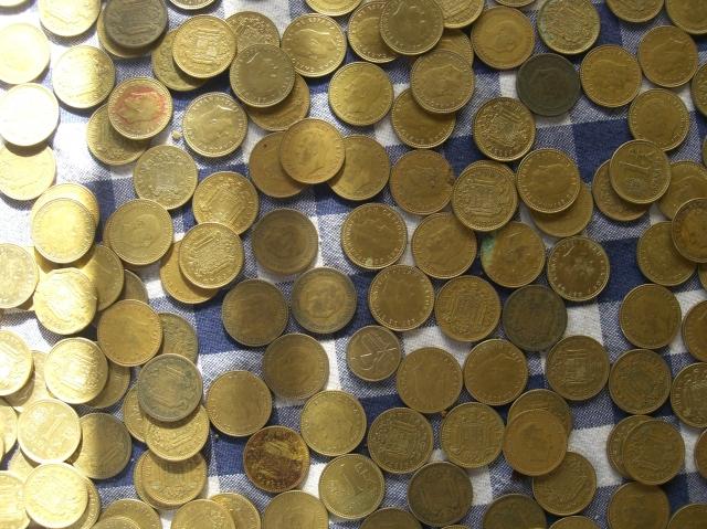 Monedas de 1 peseta rubias de Franco y el rey Juan Carlos I