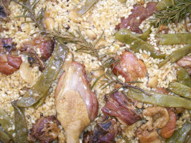 Detalle: muslo de pato, romero, judias verdes, arroz.